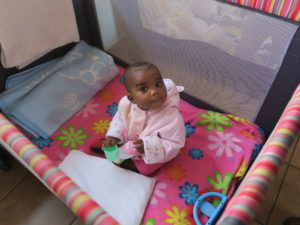 AIDS Orphans, a beautiful baby girl, one of the many children who live in the Holy Family Care Centre, Ofcolaco, South Africa.