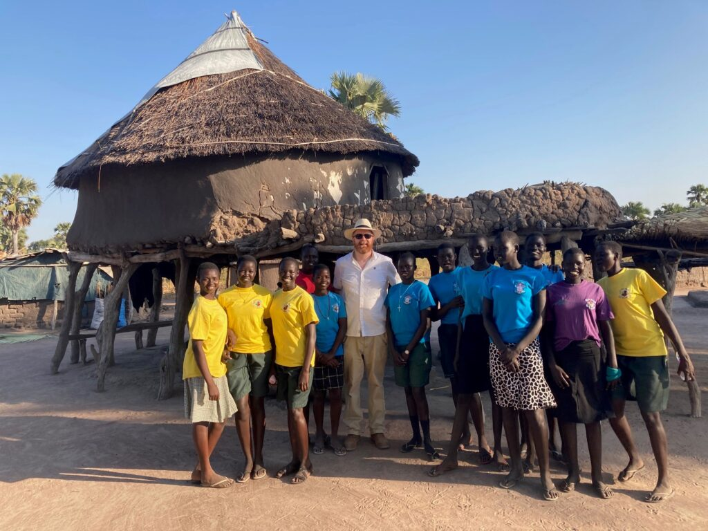 Mud huts in South Sudan with Fr Alan.