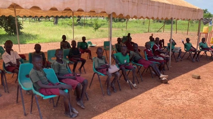 Loreto primary school students waiting their turn for malaria treatment in Rumbek, South Sudan.